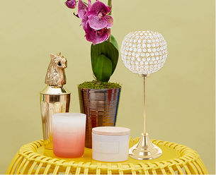 Candles, potted orchid and glass table lamp